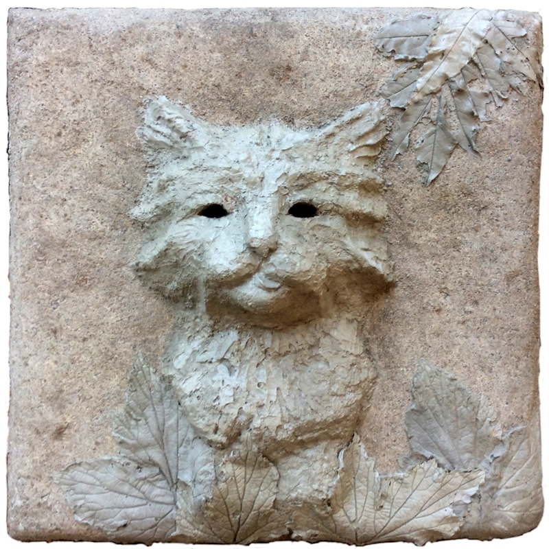 bas relief cat mde with tufa